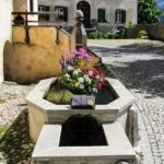 Engadine, Guarda, Fountain with two basins, with Organizational Science AG Logo