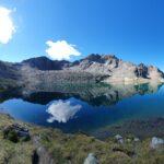 Engadine, Samaden, Muottas Muragl, Lej Muragl mirroring clouds and mountains