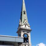 Engadine, St. Moritz Dorf, Church Tower, with Organizational Science AG Logo