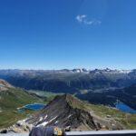 Engadine, St. Moritz, Piz Nair, view in direction Piz Nair Pitschen, Muottas Muragl with Lej Alv, Schlattain and Lake of St. Moritz, with Organizational Science AG Logo