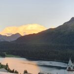 Engadine, St. Moritz, evening Sun reflects in clouds and Lake of St. Moritz